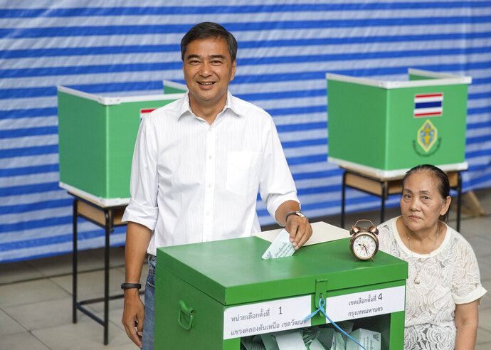 Democrat Party leader Abhisit Vejjajiva casts his vote at a polling station in Bangkok, Thailand, Sunday, March 24, 2019, during the nation's first general election since the military seized power in a 2014 coup. (AP Photo/Wason Wanichakorn)