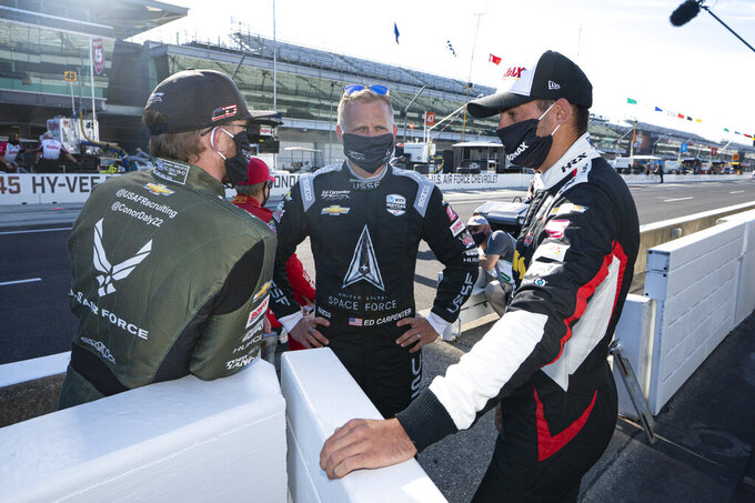 Ed Carpenter, center, talks with Conor Daly, left, and Rinus VeeKay, of the Netherlands, before practice for the Indianapolis 500 auto race at Indianapolis Motor Speedway in Indianapolis, Friday, Aug. 21, 2020. The 104th running of the Indianapolis 500 auto race is scheduled to run on Sunday.(AP Photo/Michael Conroy)