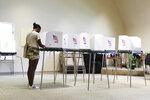 Briana Thornton votes in the state's primary election, Tuesday, June 8, 2021, at Unity Church of Tidewater in Virginia Beach, Va. (Trent Sprague/The Virginian-Pilot via AP)