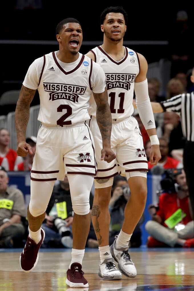 Mississippi State guard Lamar Peters, left, celebrates after scoring during the second half against Liberty in a first-round game in the NCAA men's college basketball tournament Friday, March 22, 2019, in San Jose, Calif. (AP Photo/Jeff Chiu)