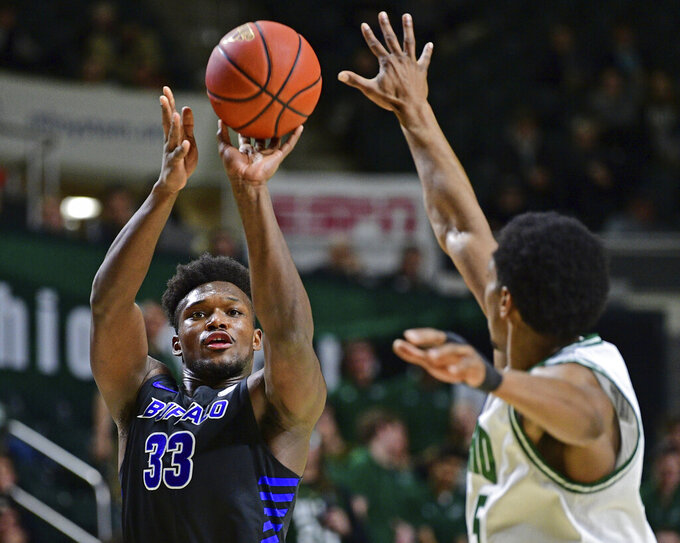 Buffalo forward Nick Perkins shoots a 3-pointer gainst Ohio forward Doug Taylor during the first half of an NCAA college basketball game Tuesday, March 5, 2019, in Athens, Ohio. (AP Photo/David Dermer)