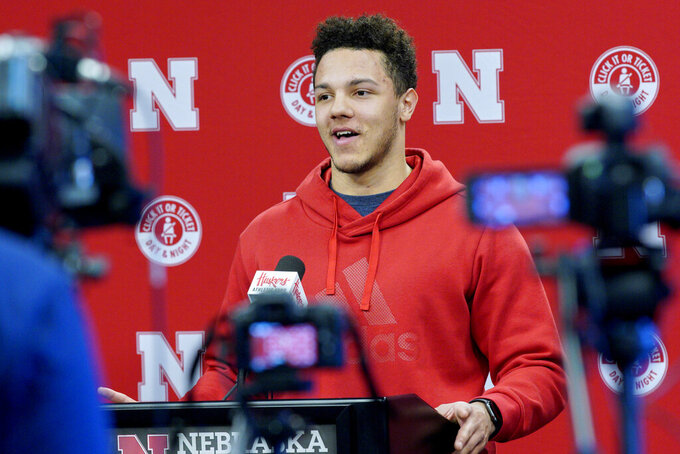 FILE - In this March 5, 2019, file photo, Nebraska quarterback Adrian Martinez answers a question during a news conference ahead of NCAA college football spring practice in Lincoln, Neb. No. 24 Nebraska is in the preseason Top 25 for the first time since 2014, and a big reason for the positive vibe is Adrian Martinez. He was the most productive freshman quarterback in the nation, and more is expected this season.  (AP Photo/Nati Harnik, File)
