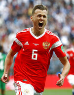 Russia's Denis Cheryshev celebrates after scoring his side's second goal during the group A match between Russia and Saudi Arabia which opens the 2018 soccer World Cup at the Luzhniki stadium in Moscow, Russia, Thursday, June 14, 2018. (AP Photo/Matthias Schrader)