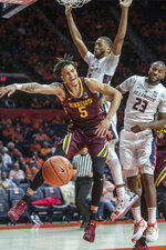 Minnesota guard Amir Coffey (5) has the ball stripped near Illinois guards Alan Griffin (0) and Aaron Jordan (23) during the second half of an NCAA college basketball game in Champaign, Ill., Wednesday, Jan. 16, 2019. (AP Photo/Rick Danzl),