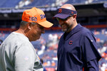 Denver Broncos head coach Vic Fangio, left, talks with Chicago Bears head coach Matt Nagy prior to an NFL football game, Sunday, Sept. 15, 2019, in Denver. (AP Photo/Jack Dempsey)