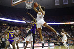 Texas forward Jericho Sims (20) pulls down a rebound over LSU forward Emmitt Williams (5) during the first half of an NCAA college basketball game, Saturday, Jan. 25, 2020, in Austin, Texas. (AP Photo/Eric Gay)