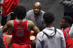 St. John's head coach Mike Anderson, top, talks with Posh Alexander (0) during a timeout in the first half of an NCAA college basketball game against Boston College, Monday, Nov. 30, 2020, in Uncasville, Conn. (AP Photo/Jessica Hill)