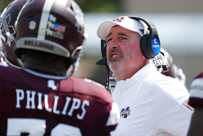 Mississippi State head coach Joe Moorhead looks at the scoreboard during the second half of their NCAA college football game against Kansas State in Starkville, Miss., Saturday, Sept. 14, 2019. Kansas State won 31-24. (AP Photo/Rogelio V. Solis)