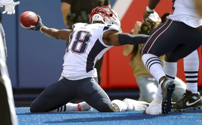 New England Patriots' Matthew Slater celebrates his touchdown after recovering a blocked punt in the first half of an NFL football game against the Buffalo Bills, Sunday, Sept. 29, 2019, in Orchard Park, N.Y. (AP Photo/Ron Schwane)