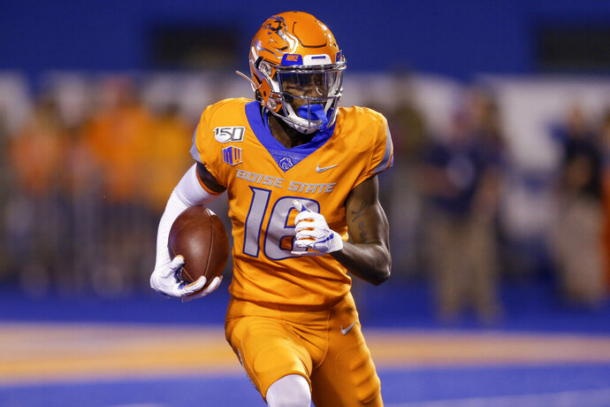 Boise State's John Hightower (16) looks upfield during a long kickoff return for touchdown during the first half of an NCAA college football game against Portland State on Saturday, Sept. 14, 2019, in Boise, Idaho. (AP Photo/Steve Conner)