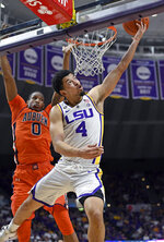 LSU guard Skylar Mays (4) puts the ball up for two points in front of Auburn forward Horace Spencer (0) in the first half of an NCAA college basketball game, Saturday, Feb. 9, 2019, in Baton Rouge, La. LSU won 83-78. (AP Photo/Bill Feig)