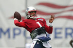 New England Patriots quarterback Cam Newton winds up for a pass during an NFL football practice, Thursday, Aug. 5, 2021, in Foxborough, Mass. (AP Photo/Steven Senne)