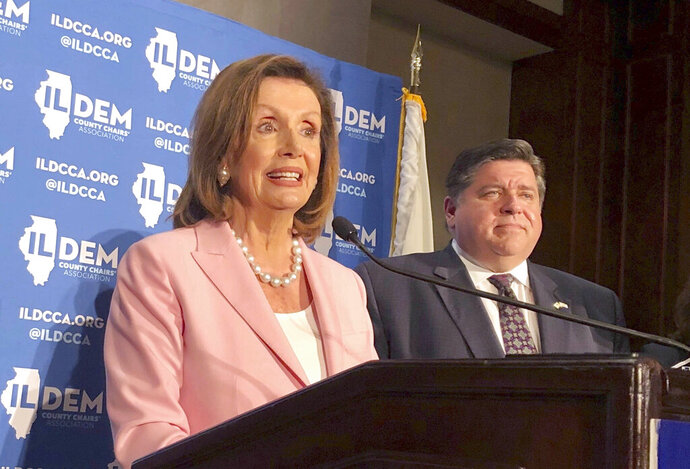 U.S. House Speaker Nancy Pelosi answers reporters' questions after keynoting the Illinois Democratic County Chairs' Association brunch Wednesday, Aug. 14, 2019 at the Illinois State Fair in Springfield, Ill. The California Democrat exhorted about 2,200 Democrats at the event to defeat Republican President Donald Trump and give Democrats a U.S. Senate majority in 2020. (AP Photo/John O'Connor)