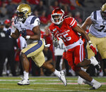 Navy fullback Jamale Carothers (34) runs past Houston linebacker Zamar Kirven (15) for a touchdown during the first half of an NCAA college football game, Saturday, Nov. 30, 2019, in Houston. (AP Photo/Eric Christian Smith)