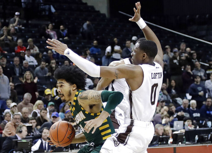 George Mason's Otis Livingston II (4) drives past St. Bonaventure's Kyle Lofton (0) during the second half of an NCAA college basketball game in the Atlantic 10 men's tournament Friday, March 15, 2019, in New York. St. Bonaventure won 68-57. (AP Photo/Frank Franklin II)