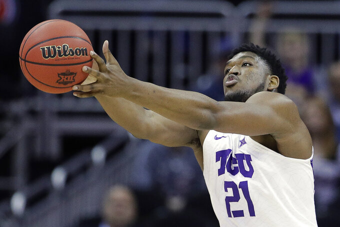 TCU's Kevin Samuel chases a loose ball during the first half of the team's NCAA college basketball game against Oklahoma State in the Big 12 men's tournament Wednesday, March 13, 2019, in Kansas City, Mo. (AP Photo/Charlie Riedel)