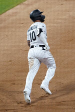 Chicago White Sox's Yoan Moncada runs the bases after hitting a two-run home run during the sixth inning of the team's baseball game against the Chicago Cubs in Chicago, Saturday, Sept. 26, 2020. (AP Photo/Nam Y. Huh)