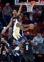 Golden State Warriors guard Alec Burks, right, shoots over Portland Trail Blazers guard Anfernee Simons during the second half of an NBA basketball game in Portland, Ore., Monday, Jan. 20, 2020. (AP Photo/Craig Mitchelldyer)