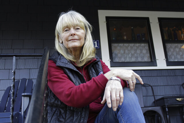 Susan Crowley, a 75-year-old retired attorney, sits outside her home in Hood River, Ore., on Jan. 23, 2021. Crowley submitted public comments to Oregon's vaccine advisory committee to criticize the state's controversial decision to vaccinate its teachers and early childhood care givers ahead of its oldest residents. Teachers in Oregon are eligible for the vaccine this week, two weeks ahead of the state's oldest residents and more than a month ahead of those between age 65 and 70. Oregon's decision underscores the difficult moral dilemma facing local and state public health officials as they weigh which populations need the vaccine most urgently amid a nationwide dose shortage. (AP Photo/Gillian Flaccus)