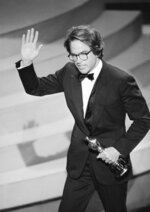 "FILE - In this March 29, 1982, file photo, Warren Beatty waves to the audience as he leaves the stage after accepting the Oscar for directing, for the movie ""Reds,"" at the Academy Awards in Los Angeles. Years before Jared Goff or any of today's Los  Angeles Rams were born, Beatty had been carried off on his teammates' shoulders to celebrate a Rams title that only Hollywood could dream up. He played quarterback Joe Pendleton in the 1978 Academy Award nominated movie ""Heaven Can Wait."" At the end, he leads LA to an otherworldly Super Bowl victory over the Steelers. (AP Photo, File)"