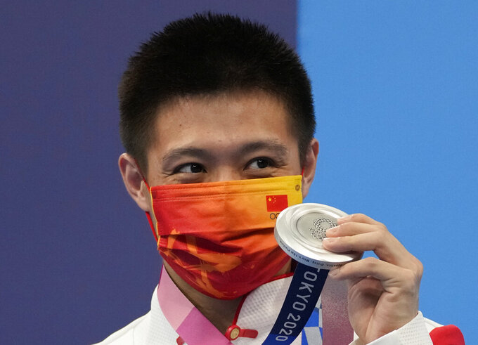 Yang Jian of China poses for a photo after winning silver medal poses for a photo in men's diving 10m platform final at the Tokyo Aquatics Centre at the 2020 Summer Olympics, Saturday, Aug. 7, 2021, in Tokyo, Japan. (AP Photo/Dmitri Lovetsky)