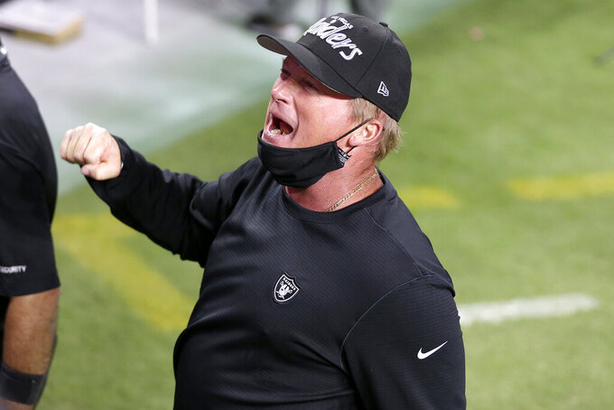 Las Vegas Raiders head coach Jon Gruden celebrates after defeating the New Orleans Saints in an NFL football game, Monday, Sept. 21, 2020, in Las Vegas. (AP Photo/Isaac Brekken)