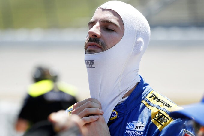 FILE - In this July 19, 2019, file photo, Alexander Rossi gets set for qualifying for an IndyCar Series auto race at Iowa Speedway in Newton, Iowa. Rossi took a huge hit in the championship race last weekend when he was wrecked on the first lap at Pocono Raceway. But he's not giving up with three IndyCar races remaining, and plans to race for wins beginning Saturday night, Aug. 24 at Gateway to climb back into the title picture. (AP Photo/Charlie Neibergall, File)
