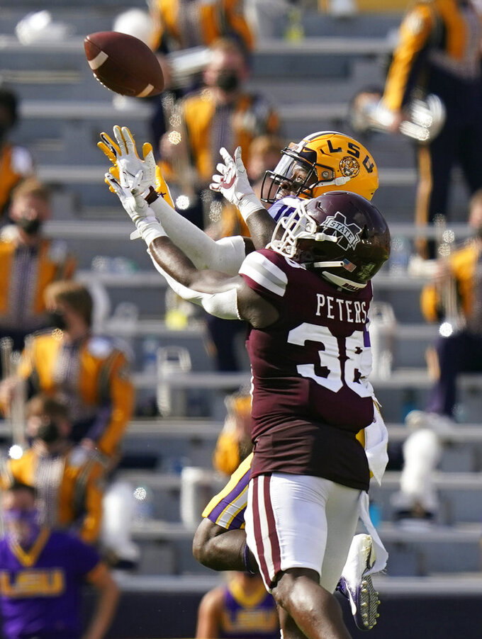 LSU wide receiver Jaray Jenkins (10) pulls in a pass over Mississippi State safety Fred Peters (38) in the first half an NCAA college football game in Baton Rouge, La., Saturday, Sept. 26, 2020. (AP Photo/Gerald Herbert)