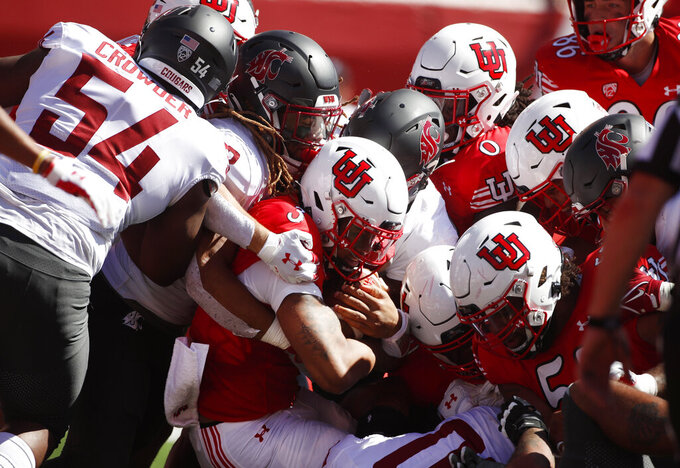 Utah quarterback Ja'Quinden Jackson (3) is gang tackled by Washington State players in the first half, of an NCAA college football game Saturday, Sept. 25, 2021, in Salt Lake City. (AP Photo/George Frey)