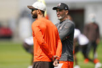 General manager and executive vice president of football operations Andrew Berry, left, and head coach Kevin Stafanski watch during an NFL football rookie minicamp at the team's training camp facility, Friday, May 14, 2021, in Berea, Ohio. (AP Photo/Tony Dejak)