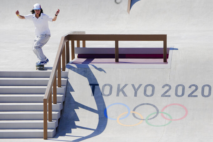 Charlotte Hym from France trains during a street skateboarding practice session at the 2020 Summer Olympics, Friday, July 23, 2021, in Tokyo, Japan. (AP Photo/Markus Schreiber)