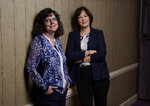 """Julie Cohen, left, and Betsy West, the co-directors of the documentary film """"Julia,"""" pose together for a portrait during the 2021 Toronto International Film Festival, at the Royal Fairmont York, Sunday, Sept. 12, 2021, in Toronto. (AP Photo/Chris Pizzello)"""