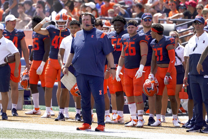 Illinois head coach Bret Bielema stands on the sidelines during the first half of an NCAA college football game against Nebraska Saturday, Aug. 28, 2021, in Champaign , Ill. (AP Photo/Charles Rex Arbogast)