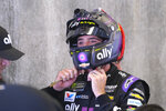 NASCAR driver Kevin Harvick removes his helmet after he qualified for the NASCAR Brickyard 400 auto race at Indianapolis Motor Speedway, Sunday, Sept. 8, 2019, in Indianapolis. (AP Photo/AJ Mast)