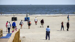 Georgia State Patrol Capt. Thornell King, bottom right, watches visitors to Tybee Island, Ga., beach after Gov. Bryan Kemp signed an executive order allowing people to exercise outside, with social distancing of at least six feet because of the coronavirus outbreak. (Stephen B. Morton/Atlanta Journal-Constitution via AP)