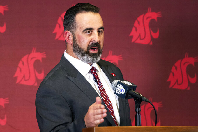 FILE - In this Thursday, Jan. 16, 2020, file photo, new Washington State head football coach Nick Rolovich speaks during an NCAA college football news conference after being officially introduced in Pullman, Wash. Normally, in March, college football teams would be preparing for the upcoming season. Because of the new coronavirus pandemic, coaches are trying to figure out how to recreate some of what has been lost. Rolovich said the Cougars will continue to learn their new offensive and defensive systems...online. (Pete Caster/Lewiston Tribune via AP, File)/