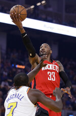 Houston Rockets' Robert Covington (33) lays up a shot over Golden State Warriors' Eric Paschall during the first half of an NBA basketball game Thursday, Feb. 20, 2020, in San Francisco. (AP Photo/Ben Margot)