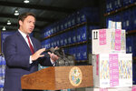 Florida Gov. Ron DeSantis speaks at a news conference at an emergency management warehouse alongside props of testing kits about the spread of the coronavirus, Friday March 13, 2020 in Tallahassee, Fla. The vast majority of people recover from the new coronavirus. According to the World Health Organization, most people recover in about two to six weeks, depending on the severity of the illness. ((AP Photo/Steve Cannon)