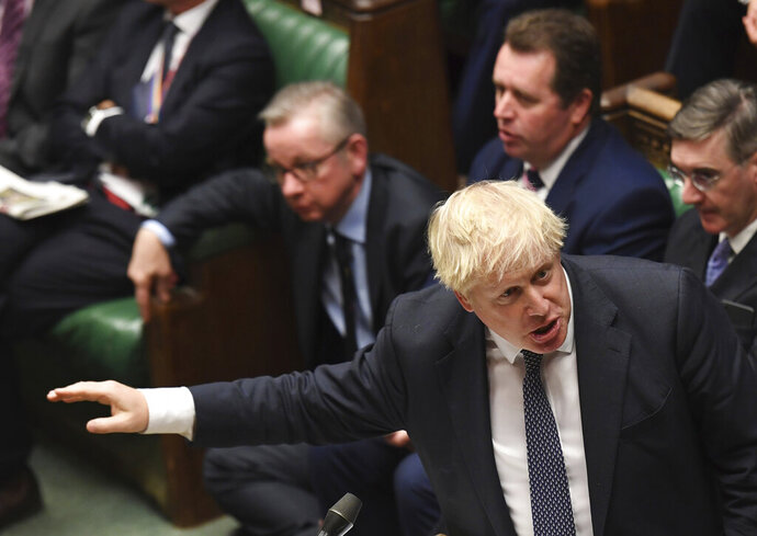 Britain's Prime Minister Boris Johnson speaks to lawmakers inside the House of Commons during the regular Prime Minister's Question time, in London Wednesday Oct. 23, 2019. According to news reports Johnson may push for an early General Election. (Jessica Taylor / House of Commons via AP)