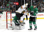 Vegas Golden Knights center Ryan Carpenter (40) leaps over a shot that Dallas Stars' Anton Khudobin blocked as defenseman Taylor Fedun (42) helps defend the net in the second period of an NHL hockey game in Dallas, Friday, March 15, 2019. (AP Photo/Tony Gutierrez)