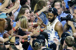 FILE - In this April 3, 2017, file photo, North Carolina guard Joel Berry II celebrates with fans after the championship game against Gonzaga at the Final Four NCAA college basketball tournament in Glendale, Ariz. North Carolina defeated Gonzaga 71-65. Berry was named MVP. (AP Photo/Matt York, File)