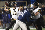 Appalachian State quarterback Peyton Derrick (13) prepares to pass as offensive lineman Chandler Greer, left, blocks Georgia Southern linebacker Benz Josue (54) during the first half of an NCAA college football game Thursday, Oct. 25, 2018, in Statesboro, Ga. (AP Photo/John Amis)