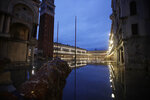St. Mark square is reflected in flood water at dawn in Venice, Italy, Sunday, Nov. 17, 2019. Venetians are bracing for the prospect of another exceptional tide in a season that is setting new records. Officials are forecasting a 1.6 meter (5 feet, 2 inches) surge Sunday. That comes after Tuesday's 1.87 meter flood, the worst in 53 years, followed by high tide of 1.54 meters on Friday. (AP Photo/Luca Bruno)