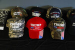 This Wednesday, Jan. 8, 2020 photo shows a display of President Trump baseball caps at the Bedford Trump Train headquarters in Temperance, Mich. The canvassing group in a township in Monroe County, is working to get out the vote for Trump. (AP Photo/Carlos Osorio)