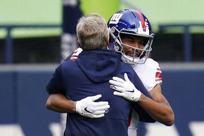 Seattle Seahawks head coach Pete Carroll hugs New York Giants wide receiver Golden Tate (15) before an NFL football game, Sunday, Dec. 6, 2020, in Seattle. (AP Photo/Elaine Thompson)