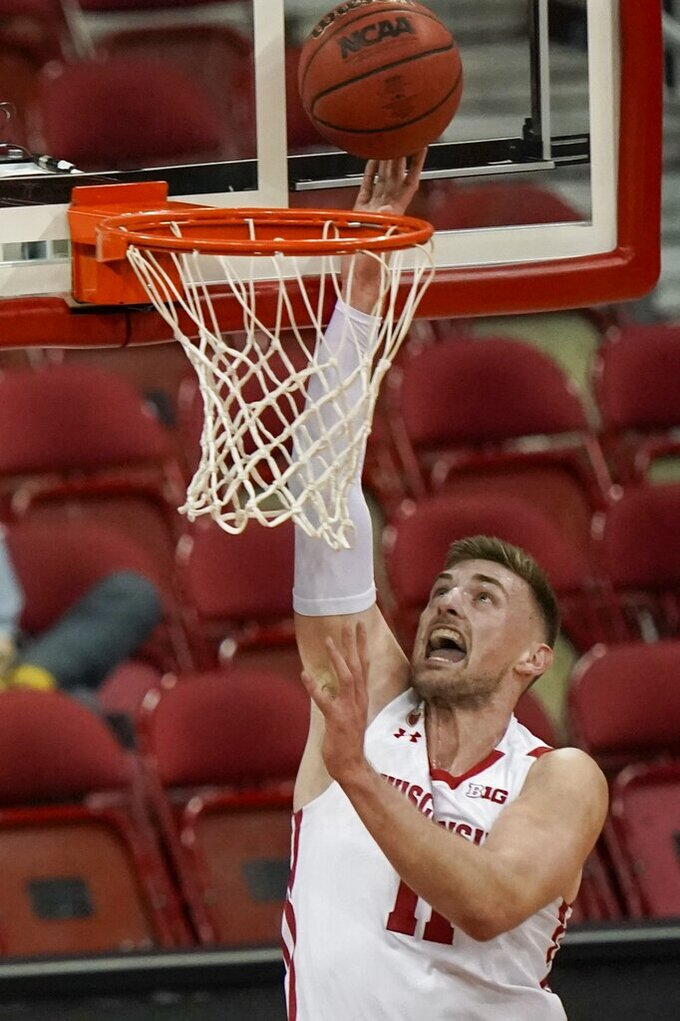 Wisconsin's Micah Potter shoots during the first half of an NCAA college basketball game against Wisconsin-Green Bay Tuesday, Dec. 1, 2020, in Madison, Wis. (AP Photo/Morry Gash)