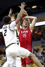 Incarnate Word's Marcus Larsson (15) heads to the basket as Missouri's Tray Jackson (2) defends during the first half of an NCAA college basketball game Wednesday, Nov. 6, 2019, in Columbia, Mo. (AP Photo/Jeff Roberson)