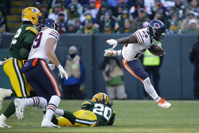 Chicago Bears' Tarik Cohen runs during the second half of an NFL football game against the Green Bay Packers Sunday, Dec. 15, 2019, in Green Bay, Wis. (AP Photo/Mike Roemer)