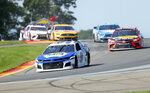 "Chase Elliott leads the field thought the area known as ""The Bus Stop"" during a NASCAR Cup Series auto race at Watkins Glen International, Sunday, Aug. 4, 2019, in Watkins Glen, N.Y. (AP Photo/John Munson)"