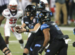 Coastal Carolina quarterback Grayson McCall (10) fakes a handoff to running back Shermari Jones (5) during the first half against Liberty in the Cure Bowl NCAA college football game Saturday, Dec. 26, 2020, in Orlando, Fla. (AP Photo/Matt Stamey)